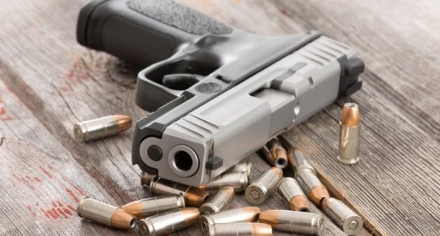 Pistol-and-ammunition-lying-on-table-via-Shutterstock-800x430